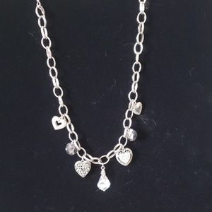 Cookie Lee silver necklace with heart charms